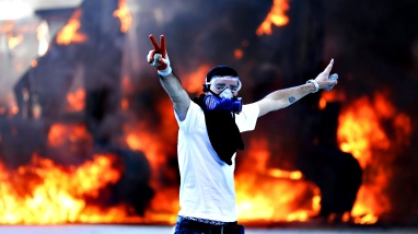 Civil unrest in Turkey...epa03740223 A protestor flashes V sign