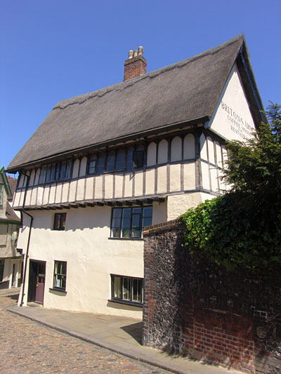 The only English example of a beguinage (a community of lay women living a life of poverty and chastity). The pretty thatched-roofed building is now the Briton's Arms Restaurant